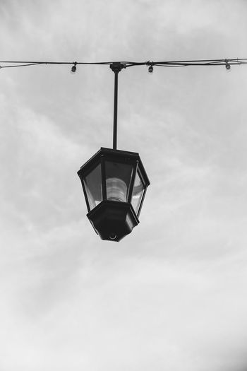 Cable Cloud - Sky Connection Day Directly Below Electric Lamp Electric Light Electrical Equipment Electricity  Hanging Light Light Bulb Light Fixture Lighting Equipment Low Angle View Metal Nature No People Outdoors Power Supply Sky Street Street Light Technology