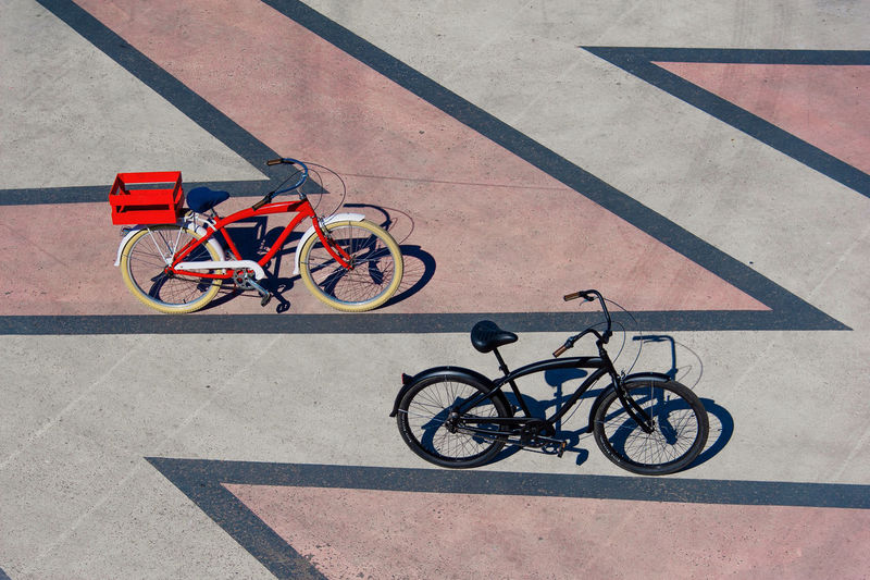 High angle view of bicycles parked on footpath