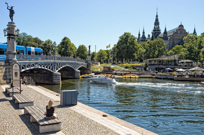 One sunny day at the Stockholm djurgarden. Bridge to the island and the Nordic museum can be seen here. Blonde Bridge Cityscapes Day Europe Nordic Countries Nordic Museum Nordiska Museet Outdoors Scandinavia Sea Spring Spring Has Arrived Stockholm Stockholm, Sweden Sweden Train Tram Water