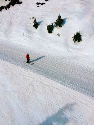 High angle view of person skiing on snow covered mountain