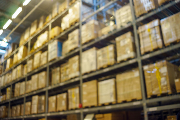 Blurred image inside a warehouse. Abstract Abundance Backgrounds Blurred Boxes Close-up Crates Detail Full Frame Geometric Shape Illuminated Level Multi Colored No People Racks Repetition Rows Selective Focus Shipment Side By Side Stocks Warehouse