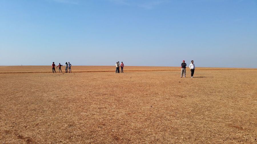 Spaces Landscape_Collection People And Places. People Of EyeEm People Together Adult Adults Only Arid Climate Clear Sky Day Desert Full Length Group Of People Landscape Men Nature Outdoors People Peoplephotography Sand Dune Sky Spaces Spaces Between Standing Togetherness