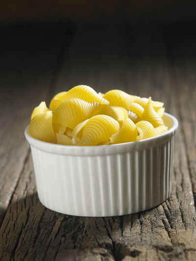 Close-up of conchiglie pasta on table