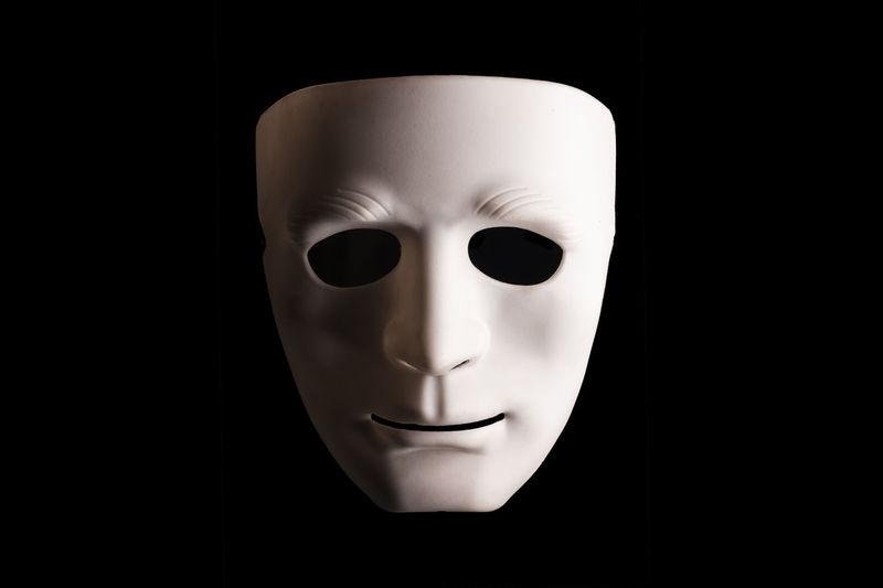 Close-up of mask against black background