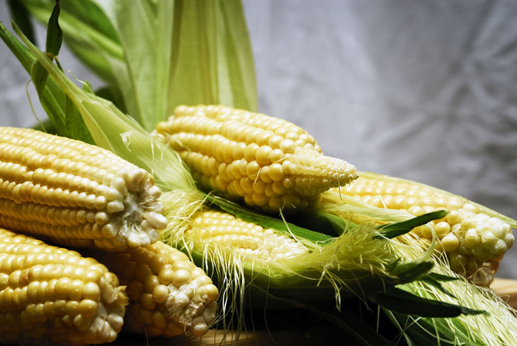 Close-up of sweetcorns on table