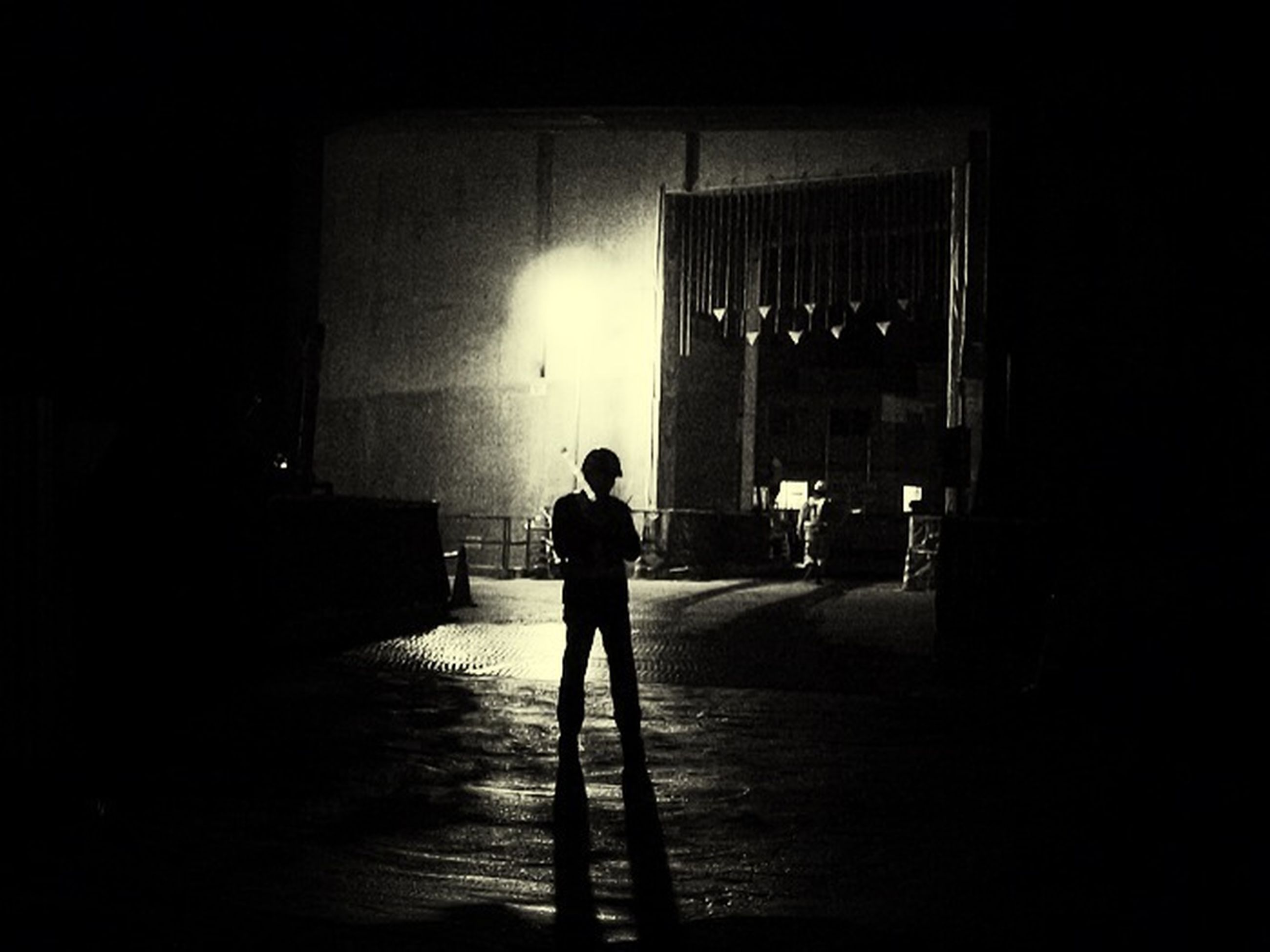 architecture, built structure, full length, building exterior, walking, indoors, lifestyles, silhouette, building, illuminated, rear view, standing, men, wall - building feature, night, leisure activity, sunlight, shadow