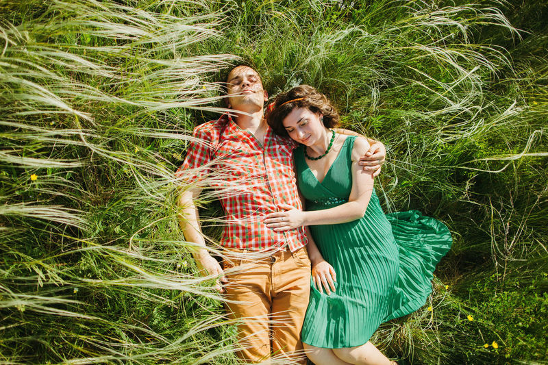 couple relax laying in green grass. Summer time. Love story Plant Nature Couple Couple - Relationship Relaxing Relationship Dating Romance Picnic Forest Green Color Summer Spring Authentic Moments Authentic Woman Men Male Love Relaxation Togetherness Together Friendship Springtime Green Grass Meadow Lifestyles Lifestyle Leisure Activity Leisure Fun Happiness Waliking  Enjoying Life Love Story Loving Sun
