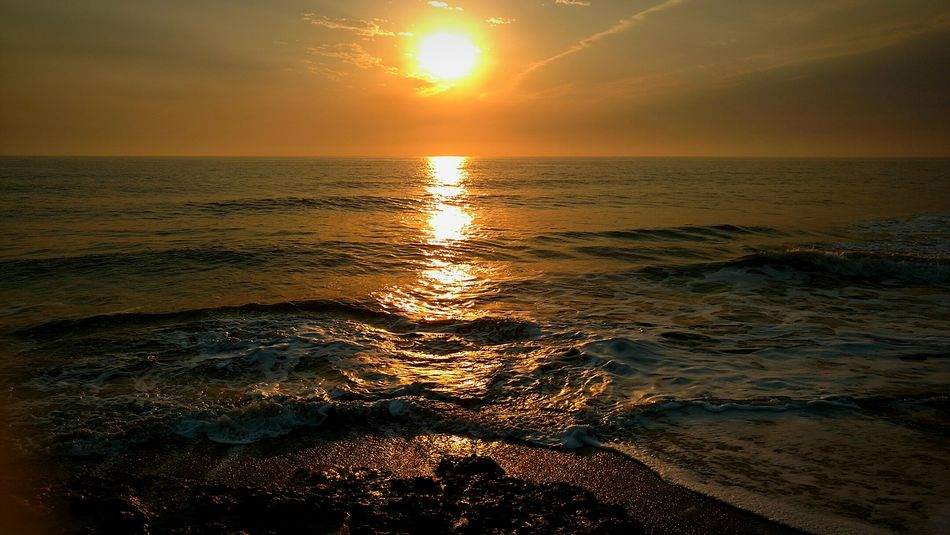 Sunset Sea Water Beach Nature Sunlight Beauty In Nature Tranquility Horizon Over Water Sun Sand Shiny Outdoors No People Scenics Sky Day