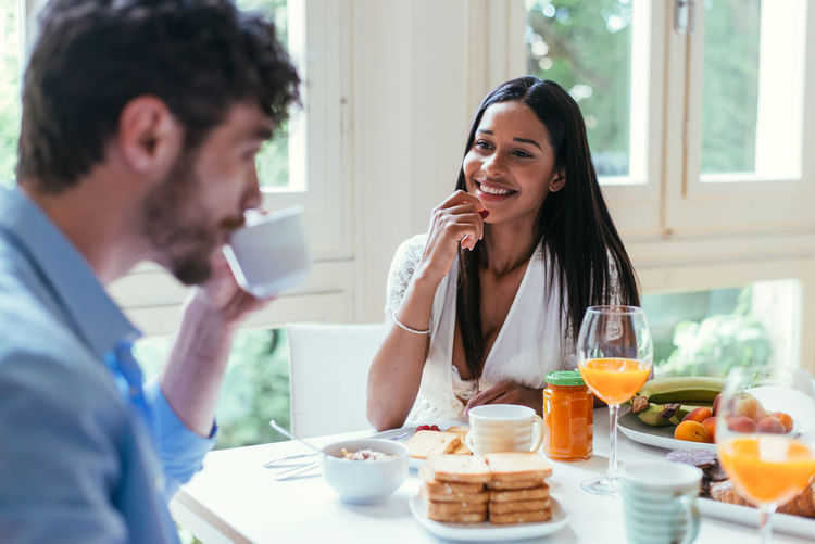 Couple having breakfast at table