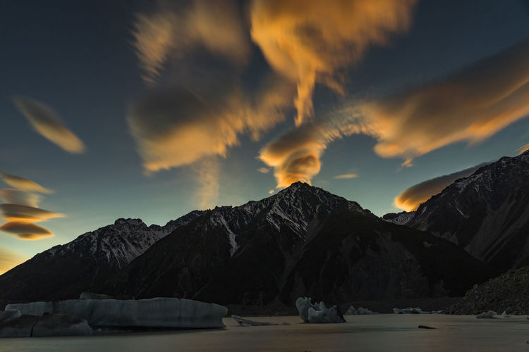 Beautiful Sunrise With Lenticular Clouds at Tasman Glacier, Canterbury, New Zealand Cloud - Sky Cold Temperature Day Dramatic Sky Iceberg Landscape Malaysian Photographer Mountain New Zealand New Zealand Scenery No Filter No People NZ Nzmustdo Outdoors Sky Snow So Sony A6000 Sony A7r,s Sony Japan South Island Sunset Tasman Glacier Area Winter