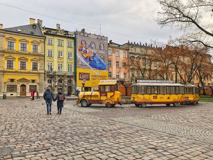 Lvov Destination Ukraine Train Lviv Building Exterior Built Structure Architecture City Mode Of Transportation Land Vehicle Real People Street Sky Transportation Day Lifestyles People Group Of People Walking City Life Leisure Activity