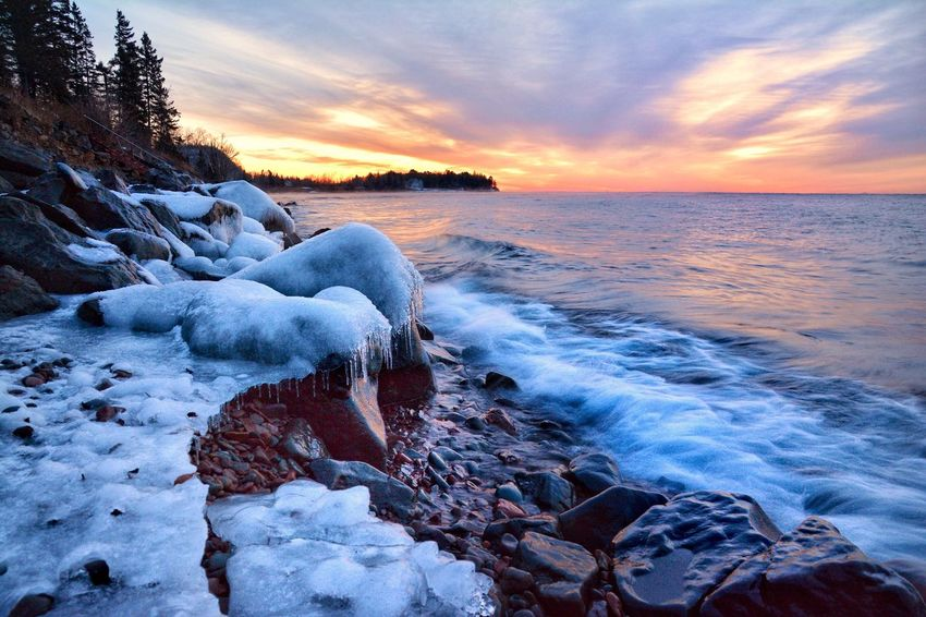 Northshore sunrise Sunset Beauty In Nature Nature Sea Sky Orange Color Scenics No People Water Cold Temperature Outdoors Frozen Ice Tranquil Scene Minnesota Malephotographerofthemonth Wave Day
