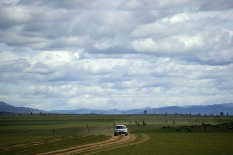 Mongolia Beauty In Nature Cloud - Sky Environment Horse Race Land Vehicle Landscape Mode Of Transportation Motor Vehicle Non-urban Scene Outdoors Scenics - Nature Sky Steppe Монгол улс