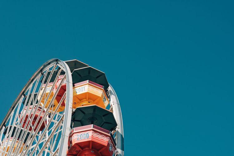 Santa Monica Pier Copy Space Amusement Park Clear Sky Arts Culture And Entertainment Low Angle View Blue Built Structure