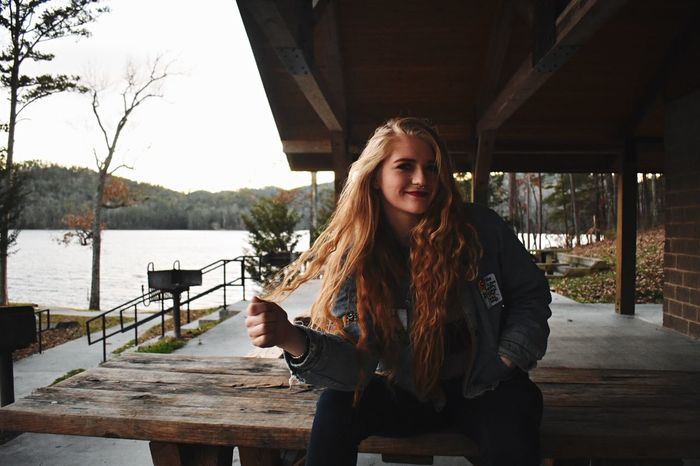 Smiling Long Hair Looking At Camera One Person Portrait Happiness Cheerful Enjoyment Leisure Activity Young Adult Fun Outdoors Young Women Only Women One Woman Only Day Standing People Nature One Young Woman Only