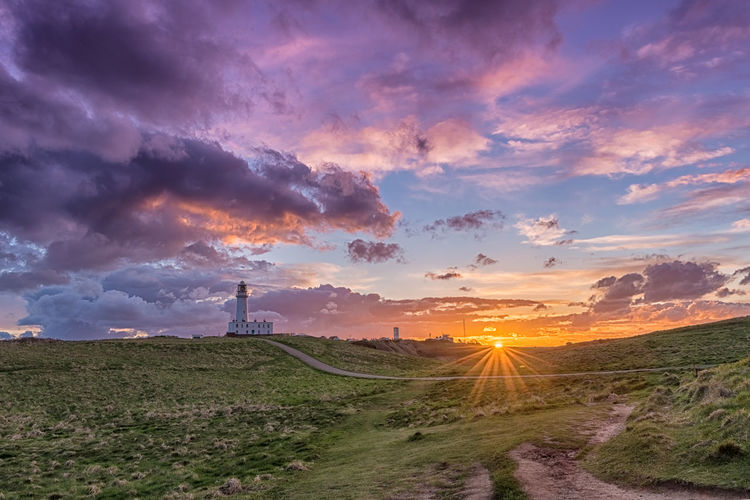 natures light Cloud Lighthouse Sunset_collection Yorkshire Beauty In Nature Cloud - Sky Environment Field Land Landscape Nature No People Non-urban Scene Orange Color Outdoors Plant Road Scenics - Nature Sky Sun Sunset Tranquil Scene Tranquility Transportation