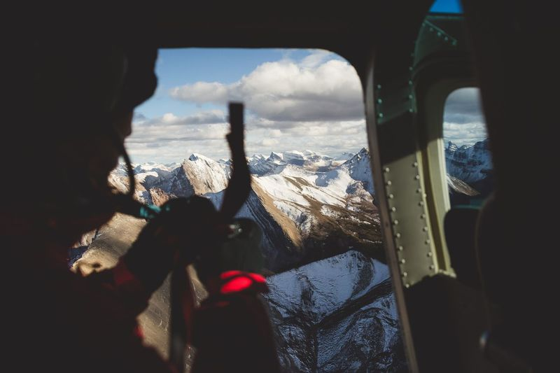 Helicopter views. Canada Sky Winter Cold Temperature Snow Mountain Scenics Cloud - Sky Nature Mountain Range Day Landscape Beauty In Nature One Person Outdoors Close-up Human Hand