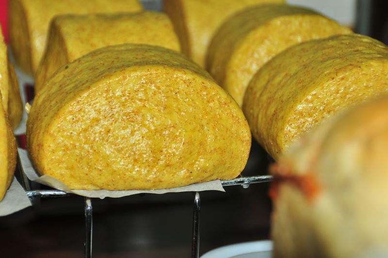 Close-Up Of Yellow Food On Cooling Rack
