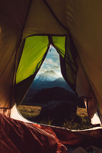 Mountains seen through tent at sunset