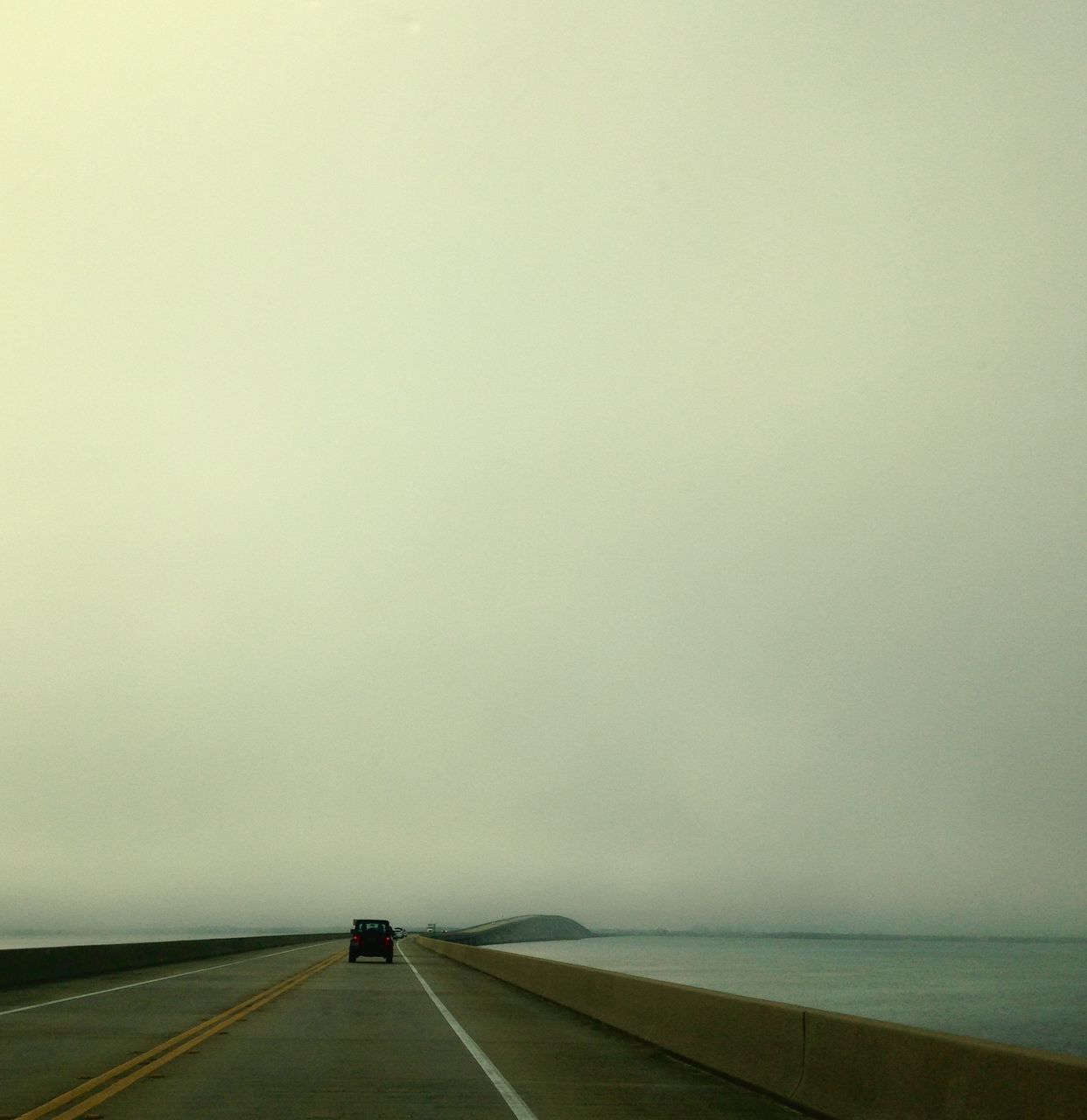 transportation, road, the way forward, car, land vehicle, mode of transport, day, fog, no people, outdoors, nature, sky