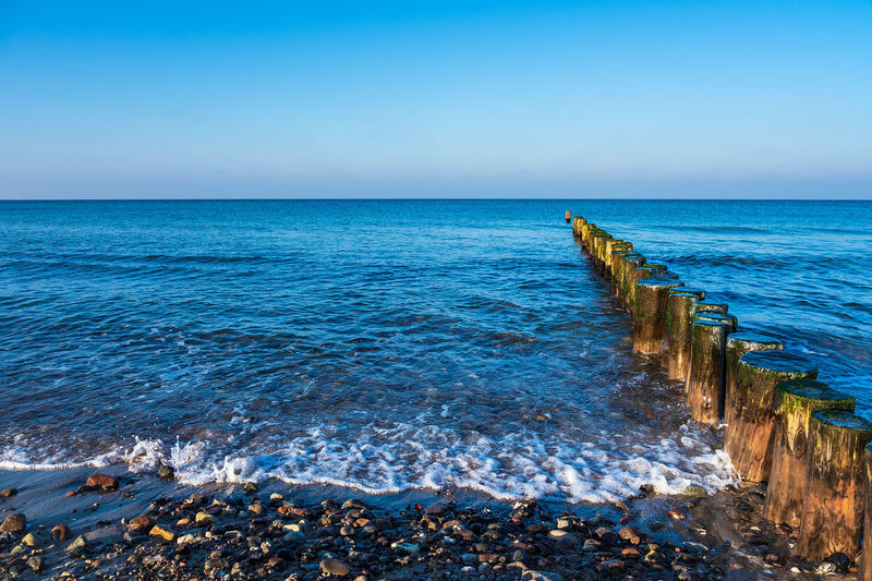 Baltic Sea coast in Graal Mueritz, Germany. Sea Horizon Over Water Water Horizon Sky Scenics - Nature Beauty In Nature Tranquil Scene Nature Beach No People Baltic Sea Graal-Müritz Graal Mueritz Coast Shore Groyne Wave Blue Vacation Travel Destinations Travel Tourism Relaxing