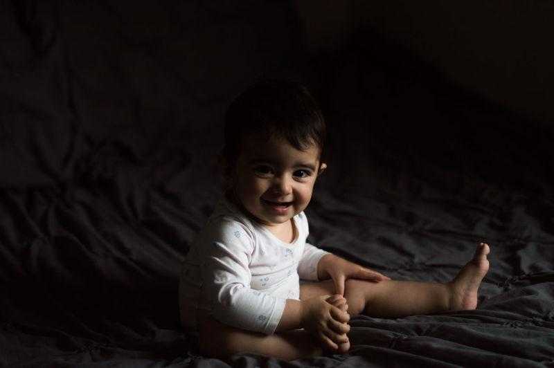 Portrait of cute girl sitting in darkroom