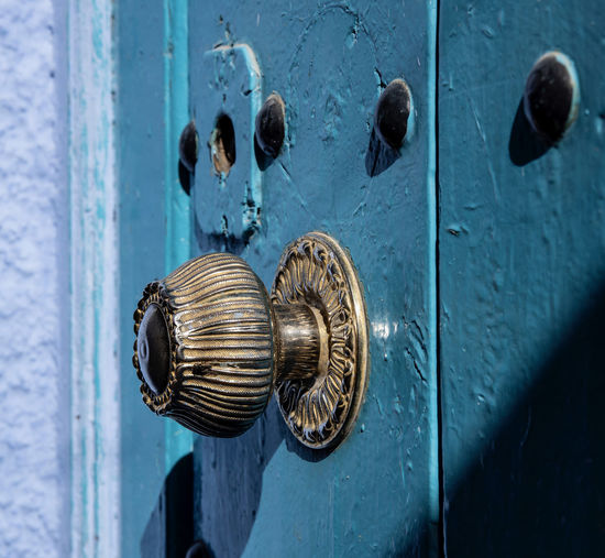 Beautiful decoration on the unique doors of the Blue City - Chefchaouen, Morocco Door Entrance Security Safety Protection Metal Close-up Doorknob Knob Full Frame No People Backgrounds Closed Wood - Material Day Blue Lock Old Pattern Focus On Foreground Silver Colored Decoration Door Knocker Door Handle Doorknobo Blue Wa