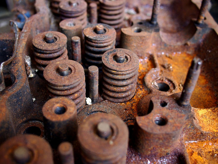 old, broken and rusty automobile engine at a junk or scrap yard Reuse Recycling Recycle Recycled Materials Junkyard Scrapyard Automobile Car Engine Engineering Motor Vehicle Corrosion Rust Junk Scrap Scrap Metal Cylinder Piston Bolt Tool Screw Machine Rusty Deterioration Iron - Metal