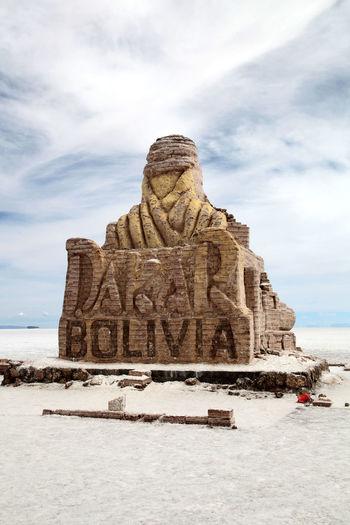 Weathered large sculpture representing dakar rally
