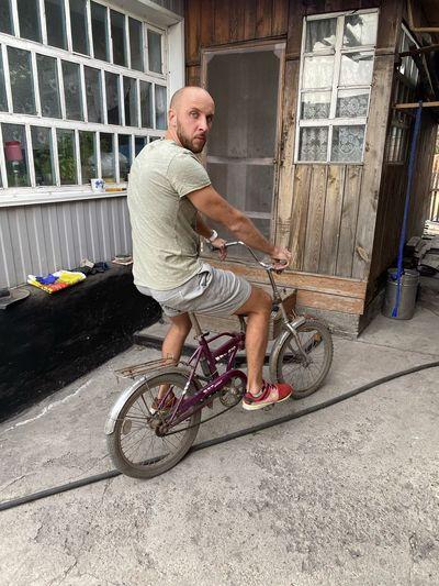Full length of man riding bicycle