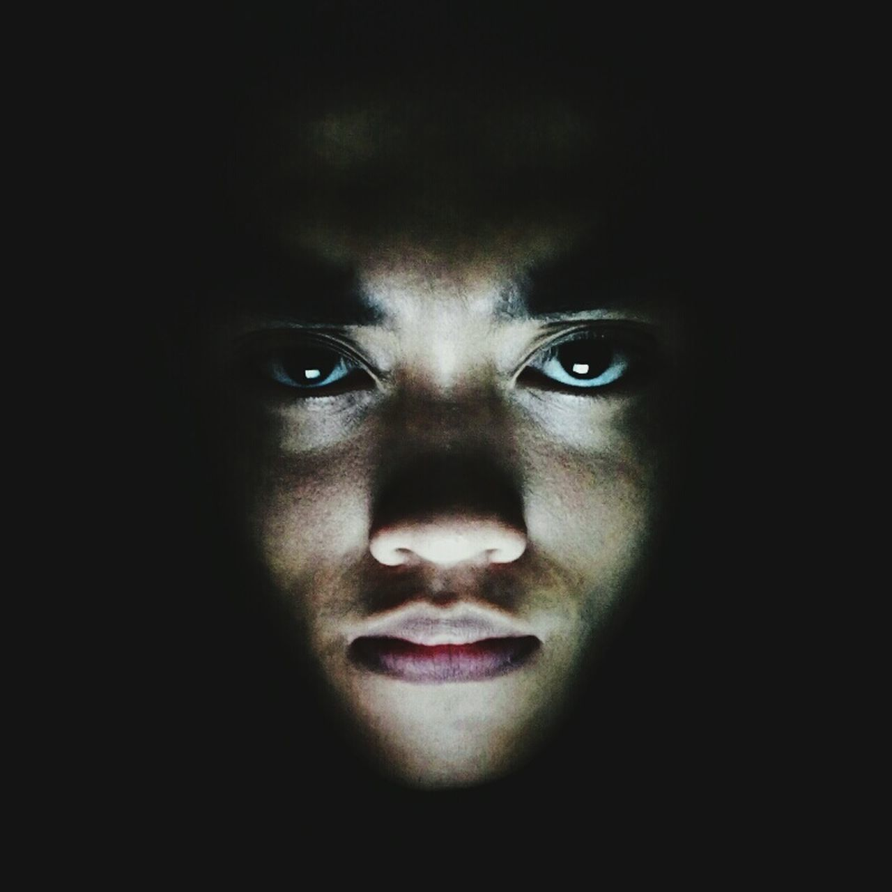 looking at camera, one person, portrait, spooky, human face, headshot, night, close-up, young adult, black background, indoors, adults only, human body part, adult, one woman only, halloween, people