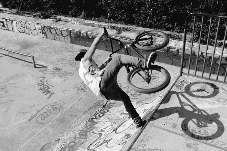 Freestyle biker Riding Shadow Outdoors Stunt Skill  Day Real People One Person Men Skateboard Park Bmx Cycling People One Man Only Cycling Freestylebmx Freestyle Biking Freestyle Freestyle Sports Sportsman Agility Bicycle Sport Low Angle View Leisure Activity Welcome To Black
