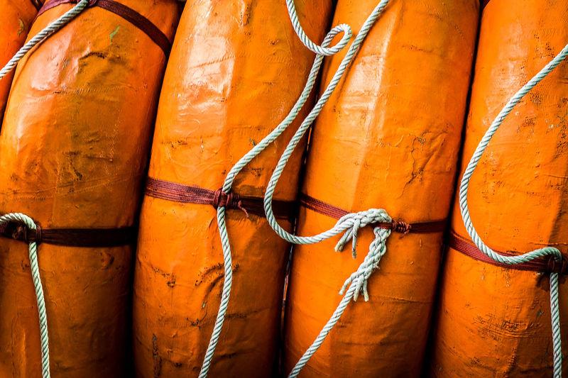 Full frame shot of orange life belts