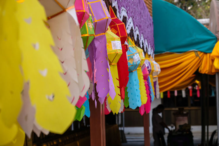 Close-up of multi colored flags hanging at market stall