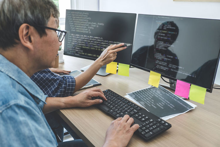 Computer programmer working in office