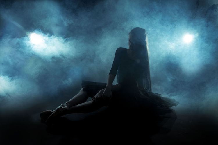 Stage Adult Adults Only Arts Culture And Entertainment Beautiful Woman Beauty Fog Full Length Illuminated Indoors  Night One Person One Woman Only One Young Woman Only People Performance Sitting Smoke - Physical Structure Stage - Performance Space Women Young Adult Young Women