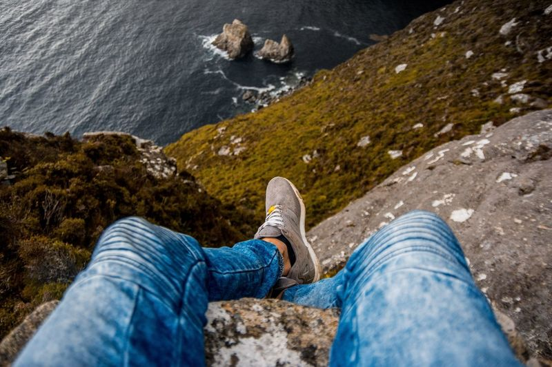 Don't look down Slieve League Low Section Standing Human Leg Men Shoe Photography Themes Hiking Blue Jeans Personal Perspective Human Foot Footwear Feet
