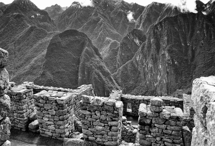 Stone wall of machu picchu against mountains
