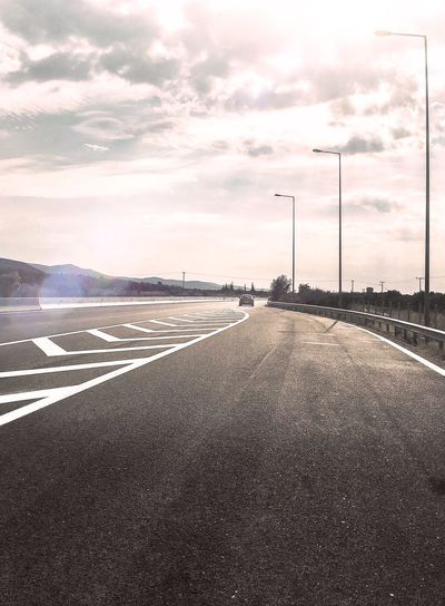 Road Street Light Road Marking Transportation The Way Forward Diminishing Perspective Sky Cloud Cloud - Sky Vanishing Point Outdoors Cloudscape Dramatic Sky Tranquil Scene Non-urban Scene Traveling On The Road Getty X EyeEm Gettyimages Gettyimagesgallery