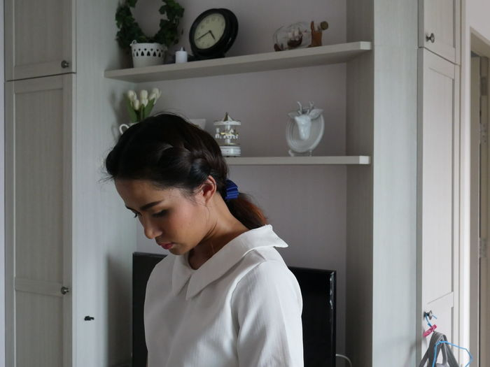 Young Woman Standing At Home
