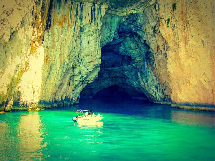 The KIOMI Collection Small Boat entering a Cave Cliff Cliffs Rock Rocks Rock Formation Cave Entrance Sea Sea Cave Rocks And Sea Rocks And Water Shades Of Blue Blue Sea Crystal Clear Waters Steep Cliff Wild Nature Greek Islands Boat Motor Boat Light And Shadow Nature Showcase April Share Your Adventure