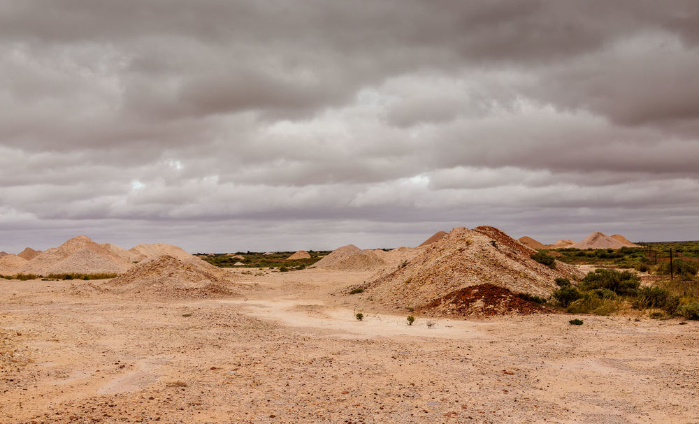 Opal diggings Arid Climate Beauty In Nature Cloud - Sky Coober Pedy Day Desert Landscape Mining Town Nature No People Opal Opal Diggings Opal Mining Outdoors Sand Scenics Sky South Australian Outback Tranquil Scene Tranquility