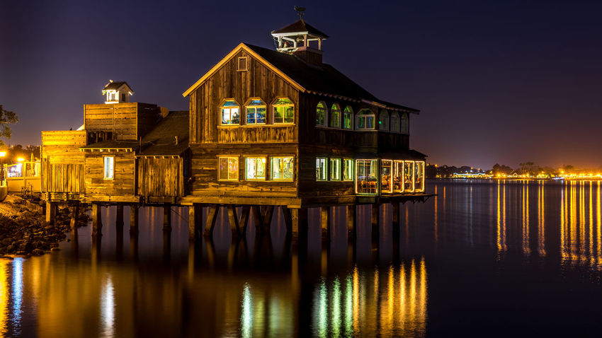 Pier Cafe, san Diego, California, USA. Flood Waters  Peaceful View Raft Houses Scenic Lookout Tourist Attraction  Tree Trunk Water Reflections Architecture Building Exterior Built Structure Exterior Design Houseboat Fun Illuminated Illustration Book Landmark Building Night No People Outdoors Property Market Reflection Sky Urban Skyline Water Waterfront Wooden Post