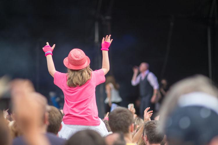 Woman cheering in pop concert