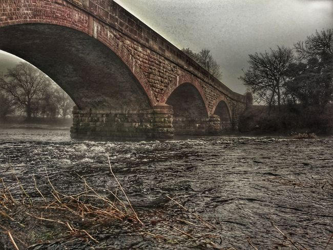 Bridge - Man Made Structure Architecture Built Structure Connection Arch Outdoors River Severn In Newtown, Winter Walking Around Riverview Riverwalk River Collection Riverside View Nature Foggy Weather Backgrounds Tree Riverside Bridge View Bridge Photography Bricks