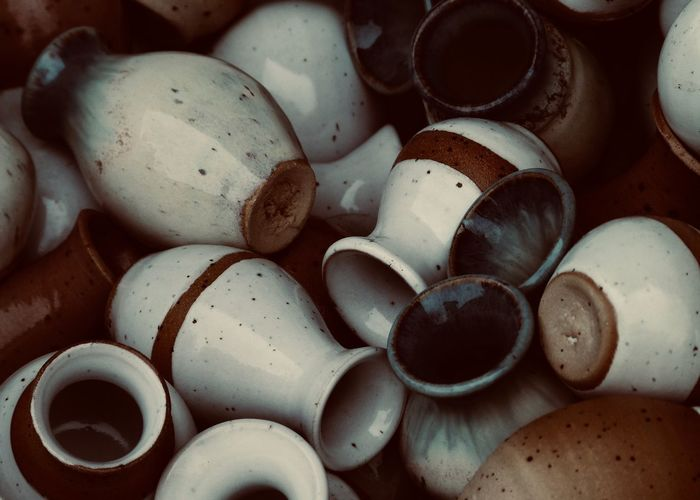 Pottery Full Frame Large Group Of Objects Still Life Backgrounds Abundance High Angle View Choice Shape Close-up Pottery Ceramics Arts Culture And Entertainment Art And Craft Craft Brown Vase Many Repetition Pattern, Texture, Shape And Form Warm Colors Design Stack