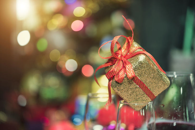 Close-up of gift box on wineglass during christmas