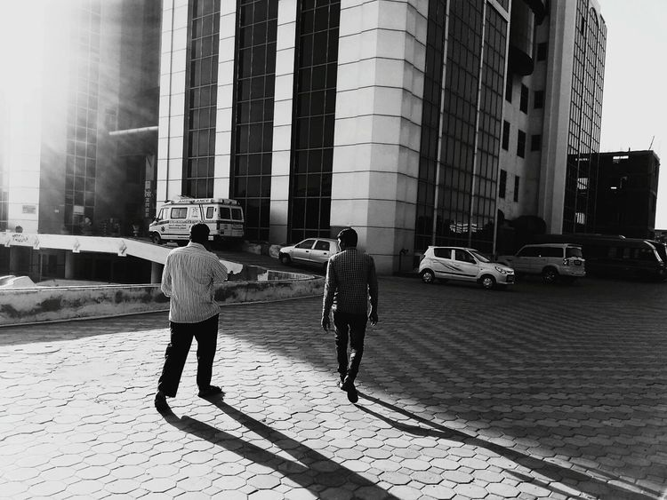 Two People Streetphotography Motion Capture People Film Photography Film Street Photography Street Life Streetphoto_bw Blackandwhite Black And White Light And Shadow Shadow Shadows & Lights Architecture Built Structure Building Exterior City Hello World Check This Out Darkness And Light Taking Photos EyeEm Best Shots Blackandwhite Photography Walking