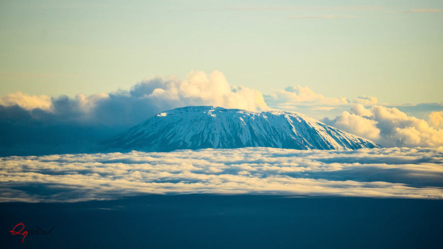 Kilimanjaro In The Clouds Kilimanjaro. Proud Above Beauty In Nature Cloud - Sky Cloudscape Day Idyllic Kilimanjaro Landscape Mountain Mountain Peak Nature No People Non-urban Scene Outdoors Power In Nature Scenics - Nature Sky Snow Snowcapped Mountain Tranquil Scene Tranquility Travel Volcanic Crater