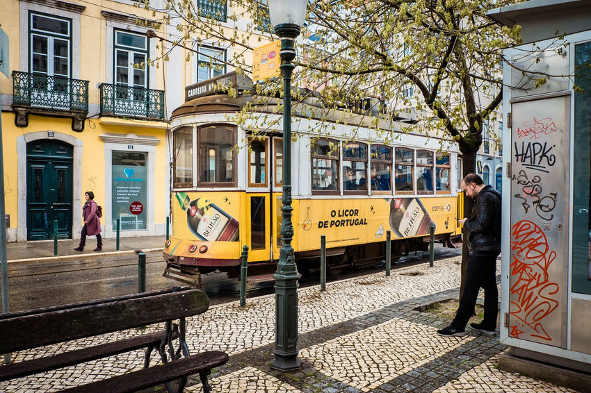 Lisbon - Portugal Lisbon Tram Public Transportation Tram Stop Architecture Building Exterior Built Structure Cable Car City Day Group Of People Lifestyles Men Mode Of Transportation Nature Outdoors People Public Transportation Rail Transportation Railroad Track Real People Text Track Transportation Tree The Traveler - 2018 EyeEm Awards #urbanana: The Urban Playground